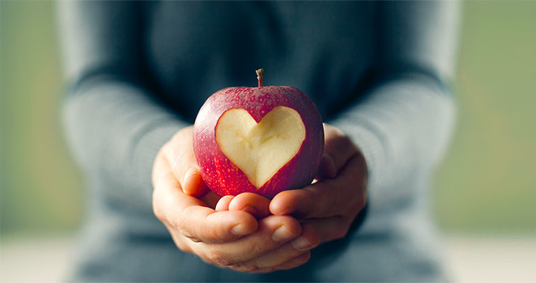 Hands holding apple